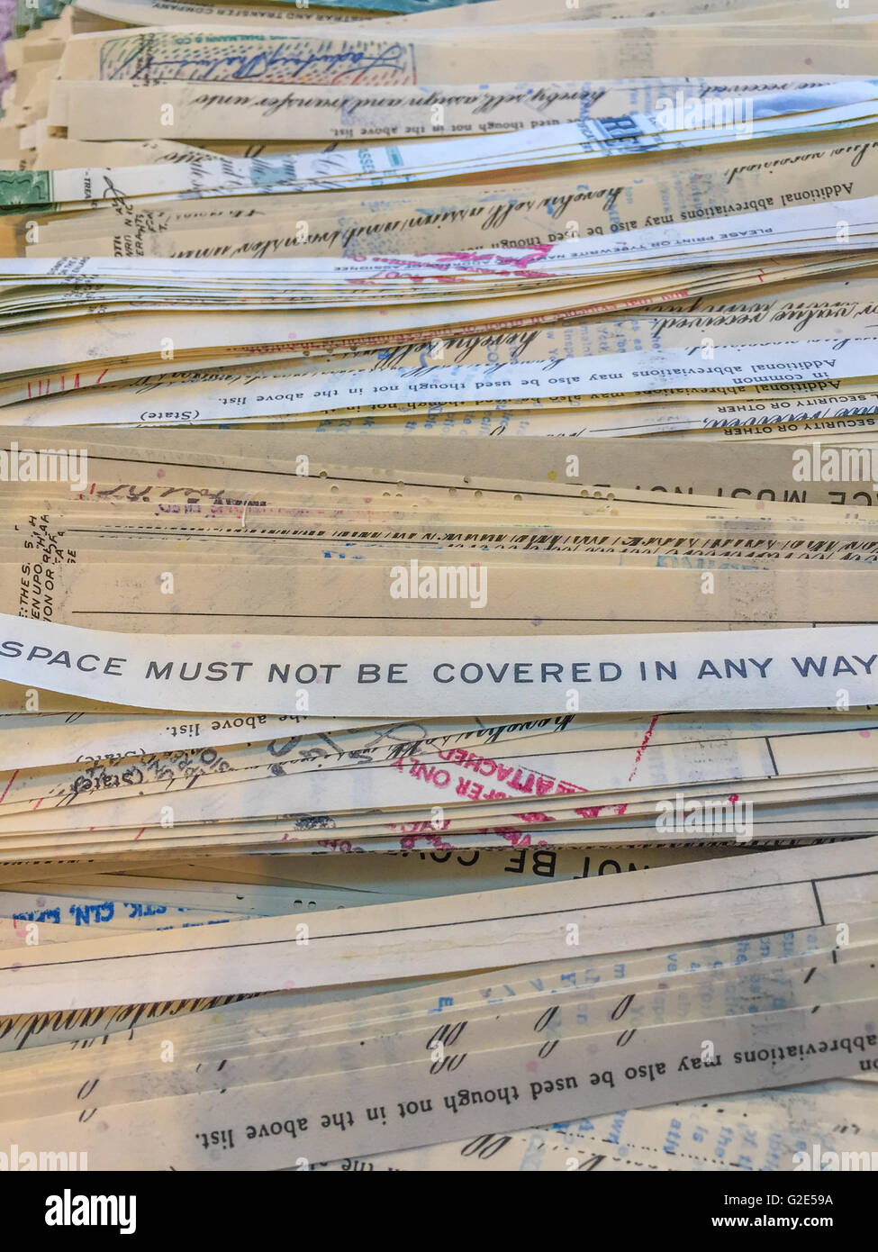 strips of old obsolete stock certificates with words Stock Photo