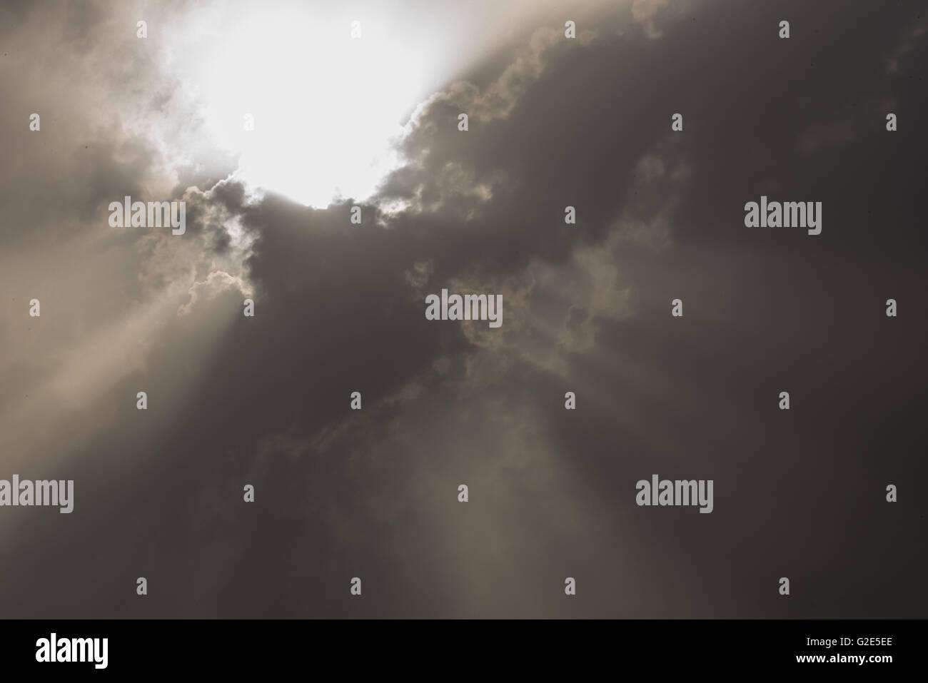 Cloud burst during sun rise Stock Photo