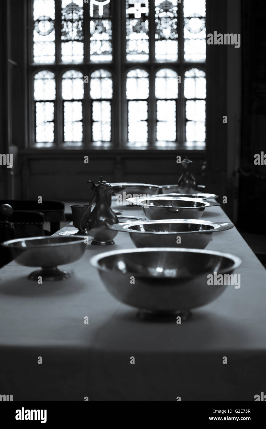 silver dishes in front of window - Stock Image