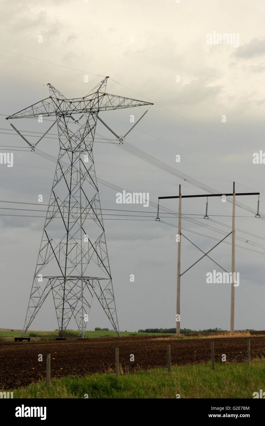 A transmission tower supporting overhead power lines on the Eastern Alberta Transmission Line in Alberta, Canada. - Stock Image