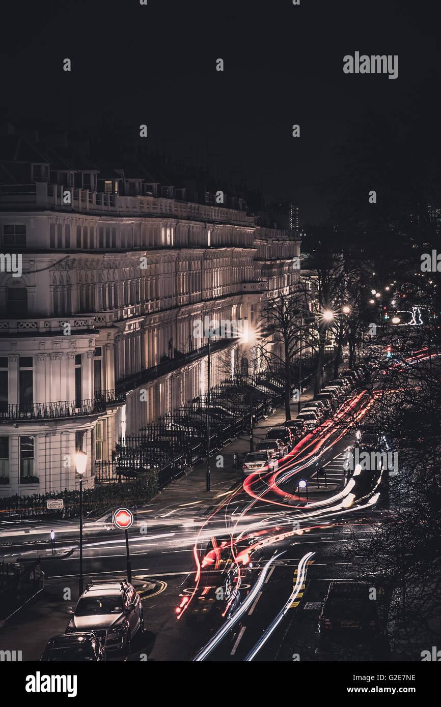 Streaking Car Lights Along Street at Night, London, England, UK - Stock Image