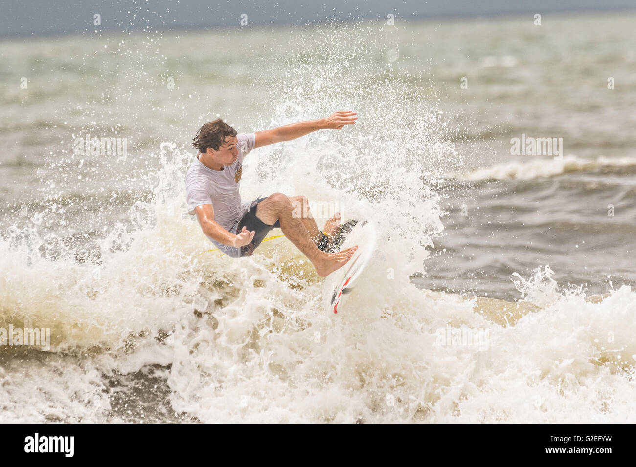 Folly Beach, South Carolina, USA. 29th May, 2016. Surfers take advantage of the waves as Tropical Storm Bonnie, - Stock Image