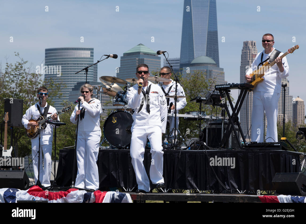 US Navy band playing on stage in front of the NYC skyline. Fleet Week event at Liberty State Park. - Stock Image