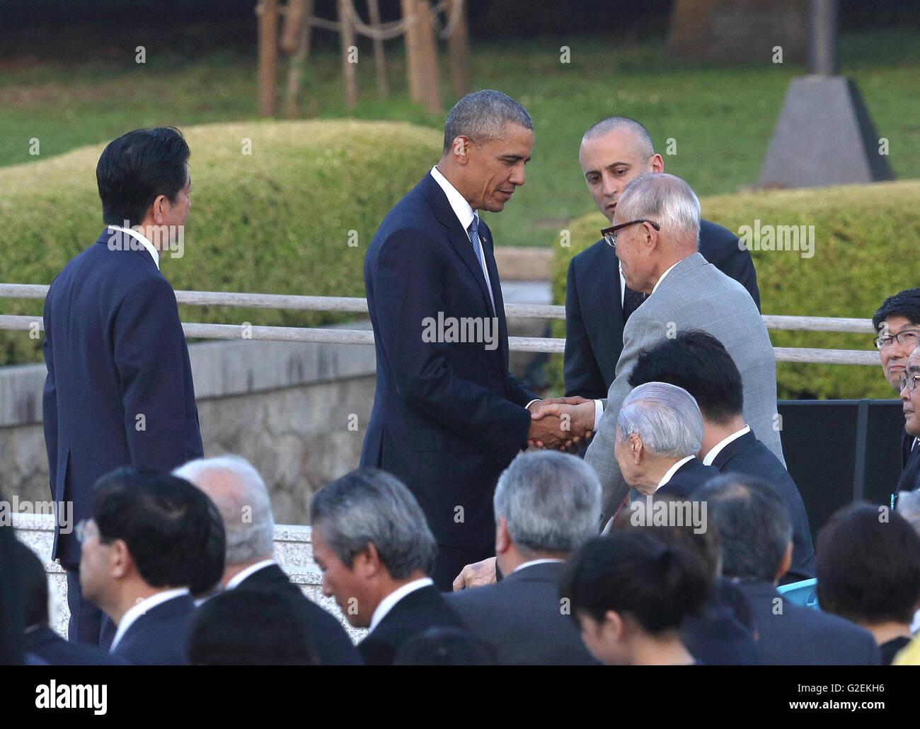 U.S. president Barack Obama talks with an atomic bomb survivor Shigeaki Mori at Hiroshima Peace Memorial Park in Hiroshima, Japan on May 27, 2016. © Motoo Naka/AFLO/Alamy Live News Stock Photo