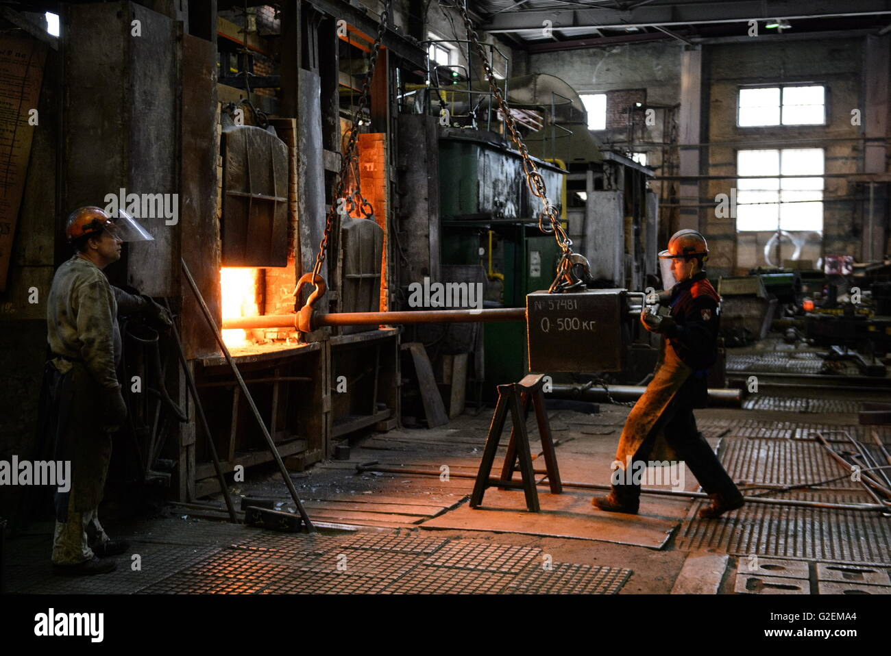 YEKATERINBURG, RUSSIA - MAY 20, 2016: Workers in a forging shop. Ural Turbine Works is a power machine-building - Stock Image
