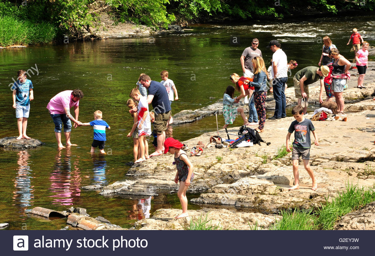 Holidaymakers enjoying the River Dee at Llangollen in Denbighshire, Wales. - Stock Image