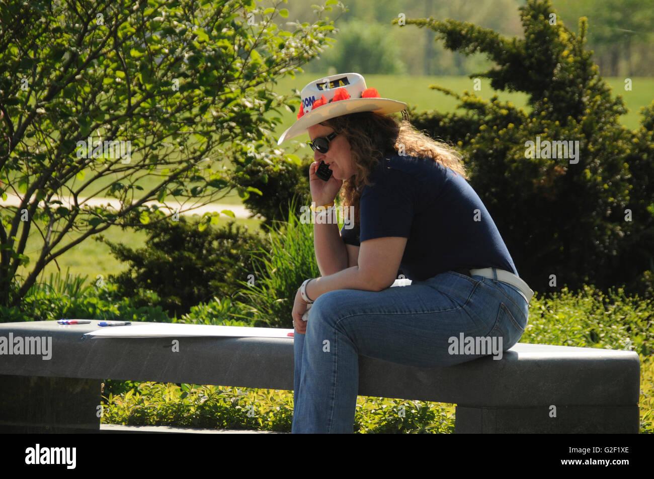 Tea Party demonstrator in Washington DC at the Washington Monument talks on the phone - Stock Image