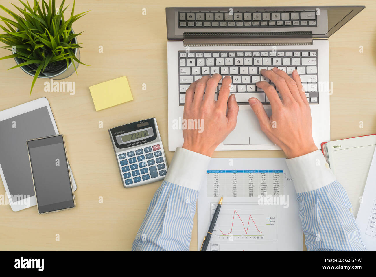 Businessman making calculation - Stock Image