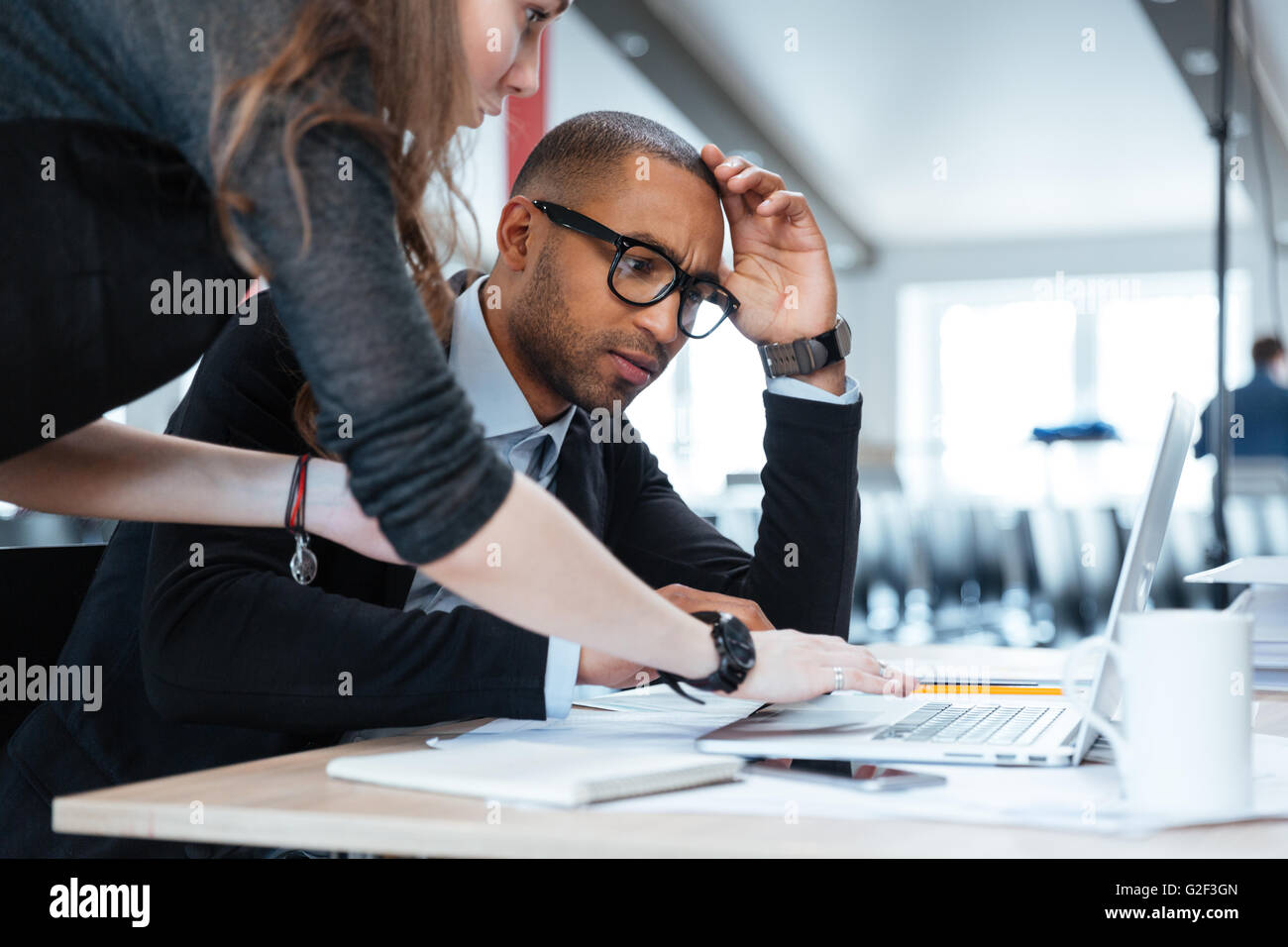 Young business crew working with new startup project laptop at the office - Stock Image