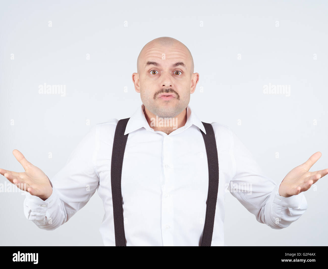 bald man shrugging shoulders I don't know gesture Isolated.  Human body language. - Stock Image