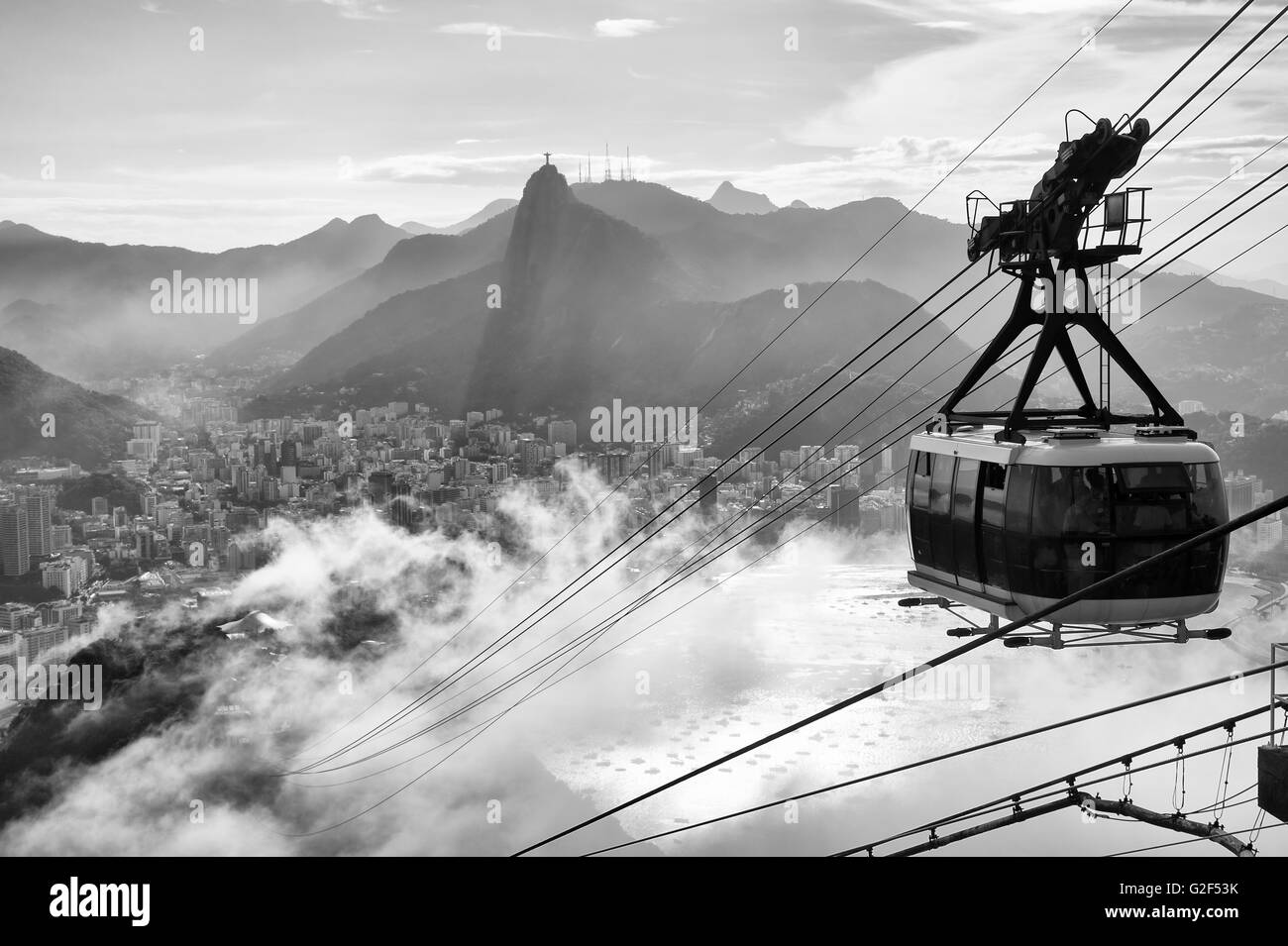Black and white view of the misty city skyline of rio de janeiro brazil with a sugarloaf pao de acucar mountain cable car