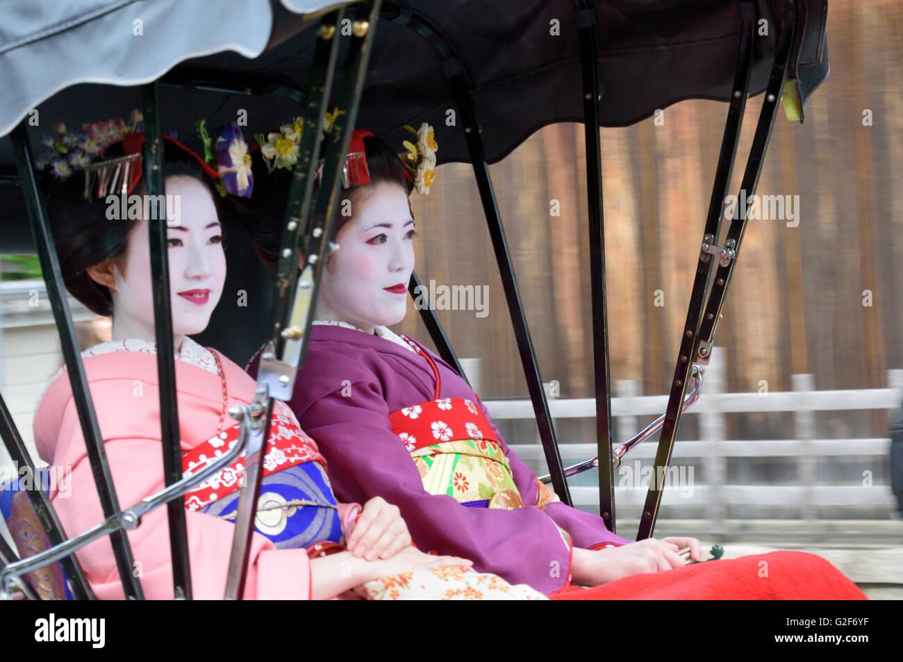 Maiko Sitting in Rickshaws Stock Photo