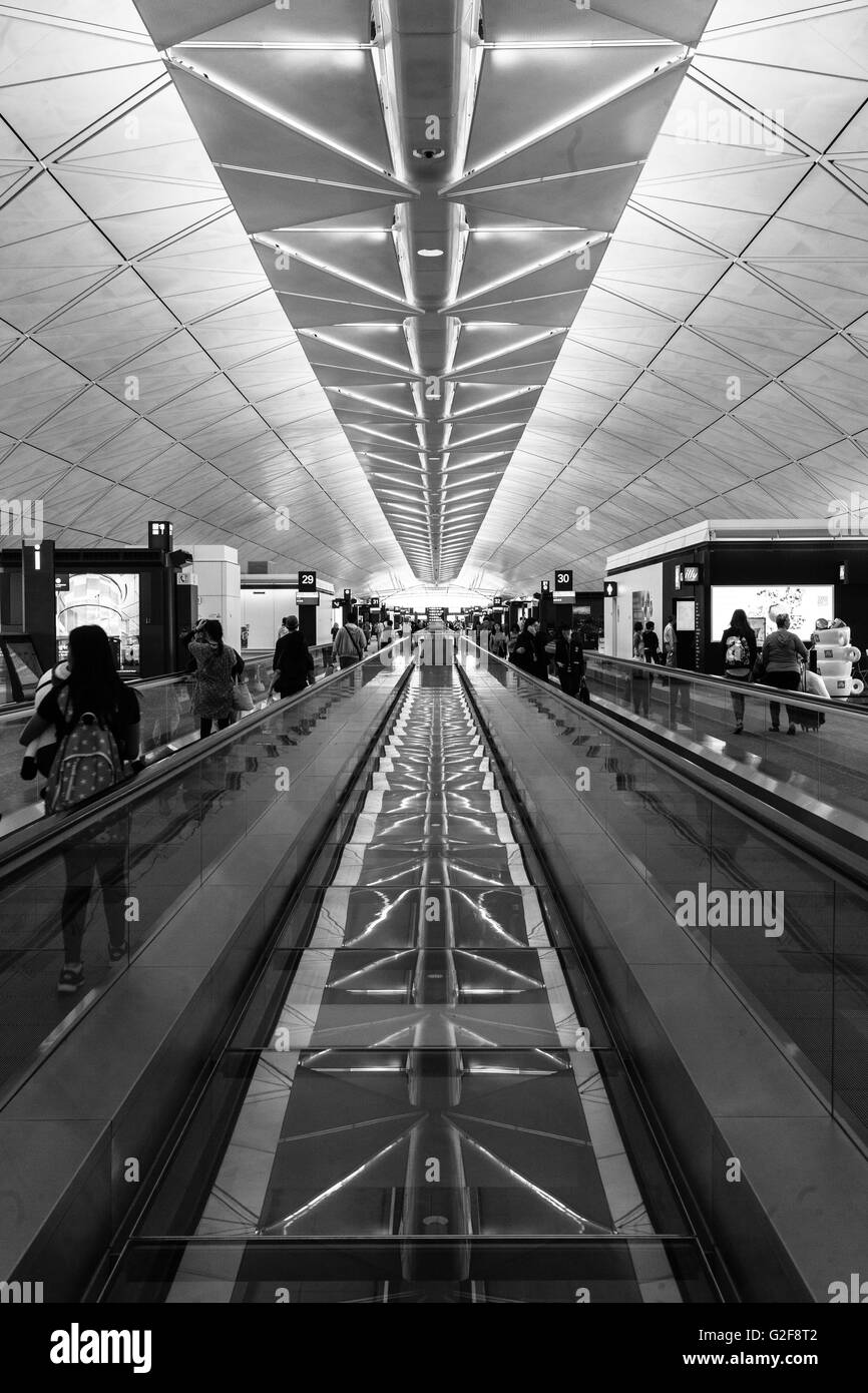 strong architectural lines of the Hong Kong airport, the ceiling the floor, all pointing to the a central vanishing - Stock Image