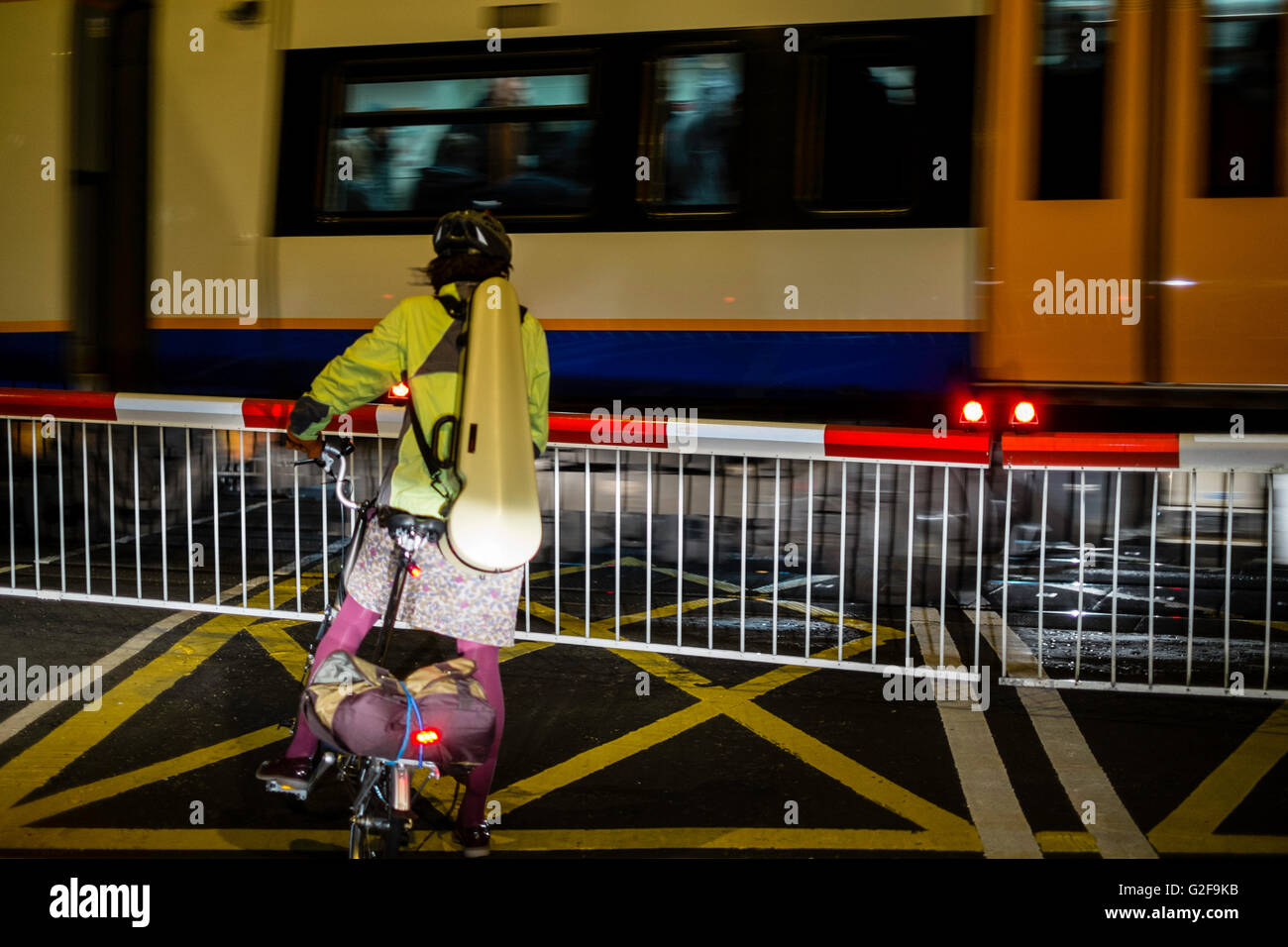 London UK lever crossing train cyclist road rail - Stock Image