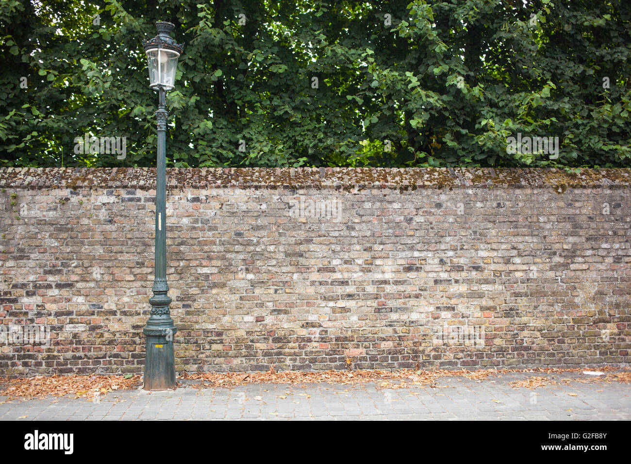 lamp post street on the left on brick wall background stock photo