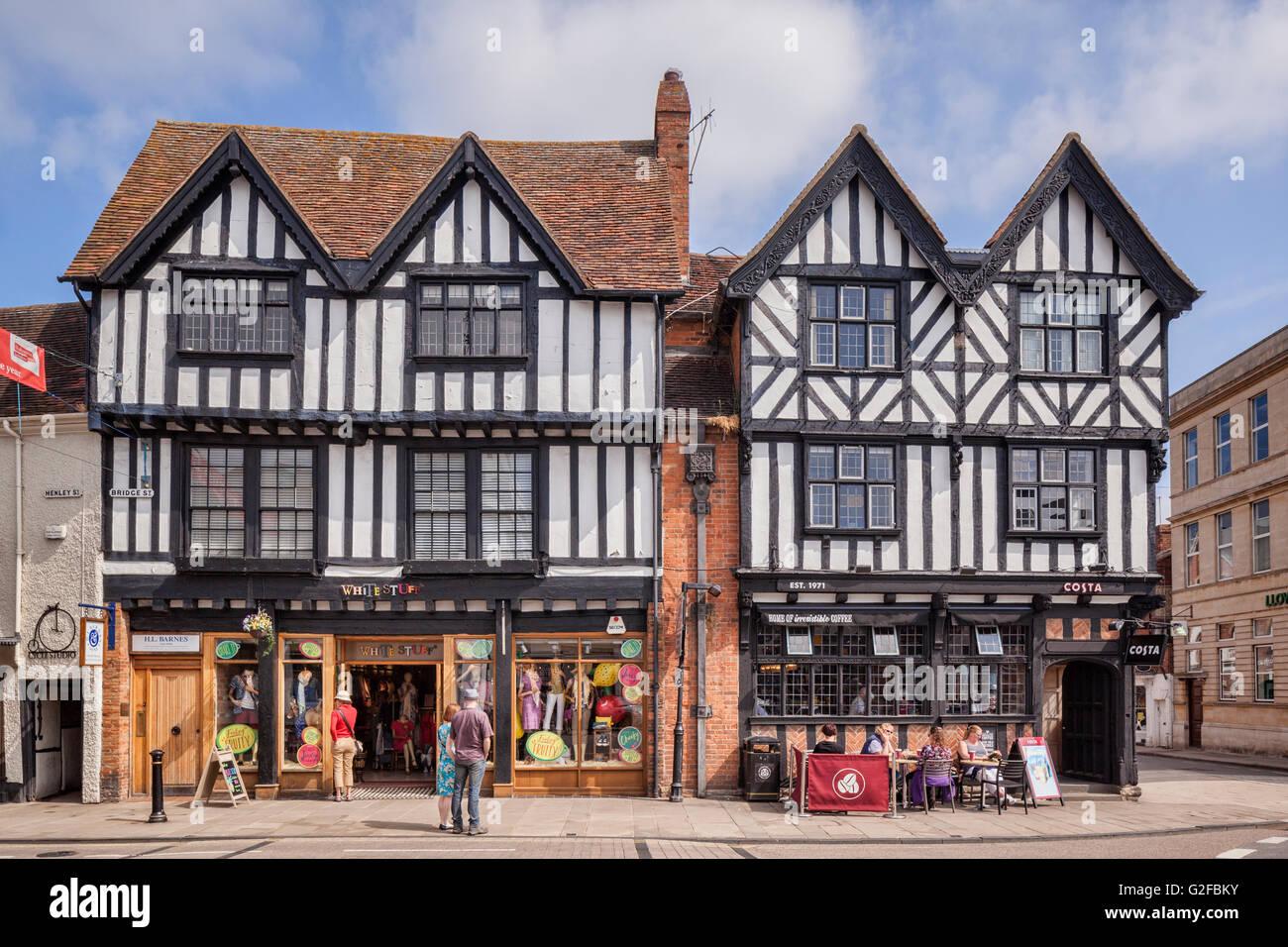 Shops in half-timbered buildings in Bridge Street, Stratford-upon-Avon, Warwickshire, England, UK - Stock Image