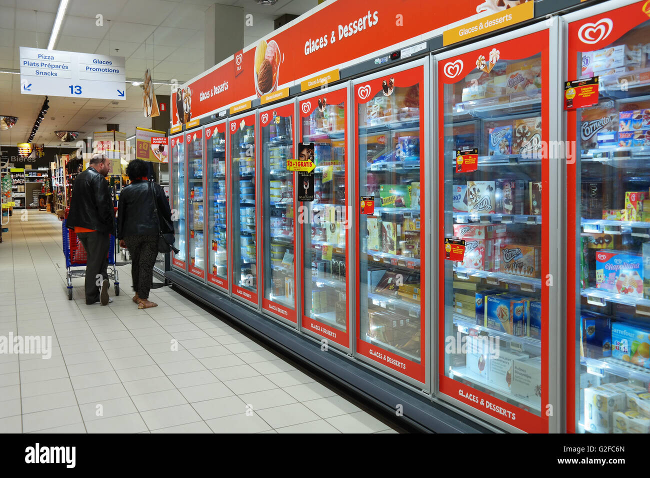 Freezer department with Ice cream of Unilever Heartbrand in a Carrefour Hypermarket. - Stock Image