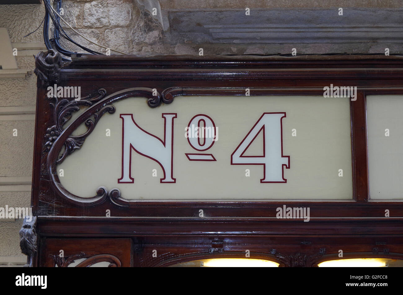 Girona, Spain, No 4, ie Number 4, on shop fascia - Stock Image