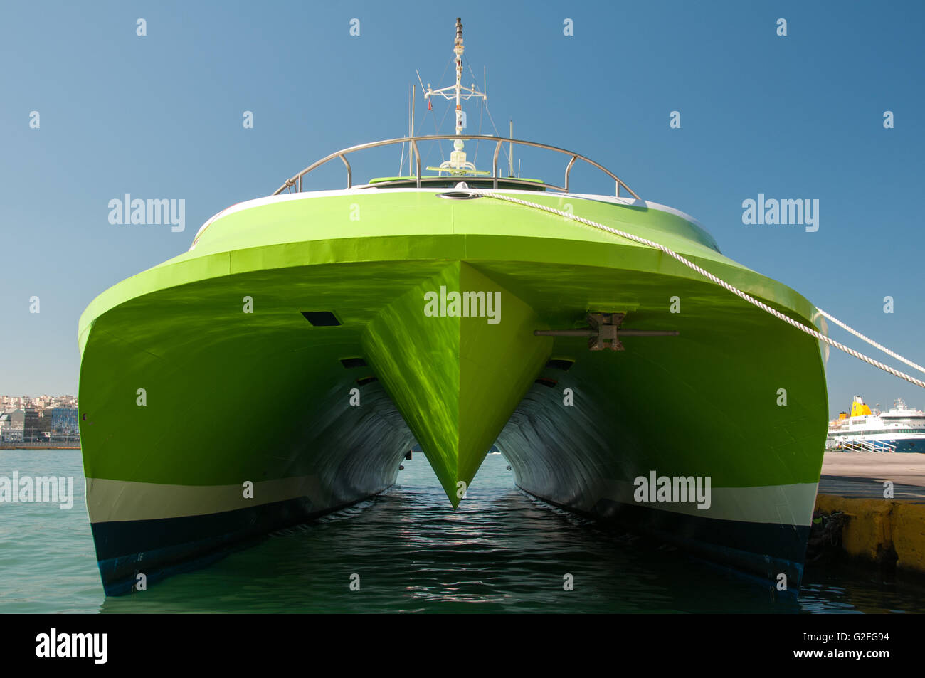 Lime green speedboat ship docked at Piraeus Port in Athens, Greece. - Stock Image