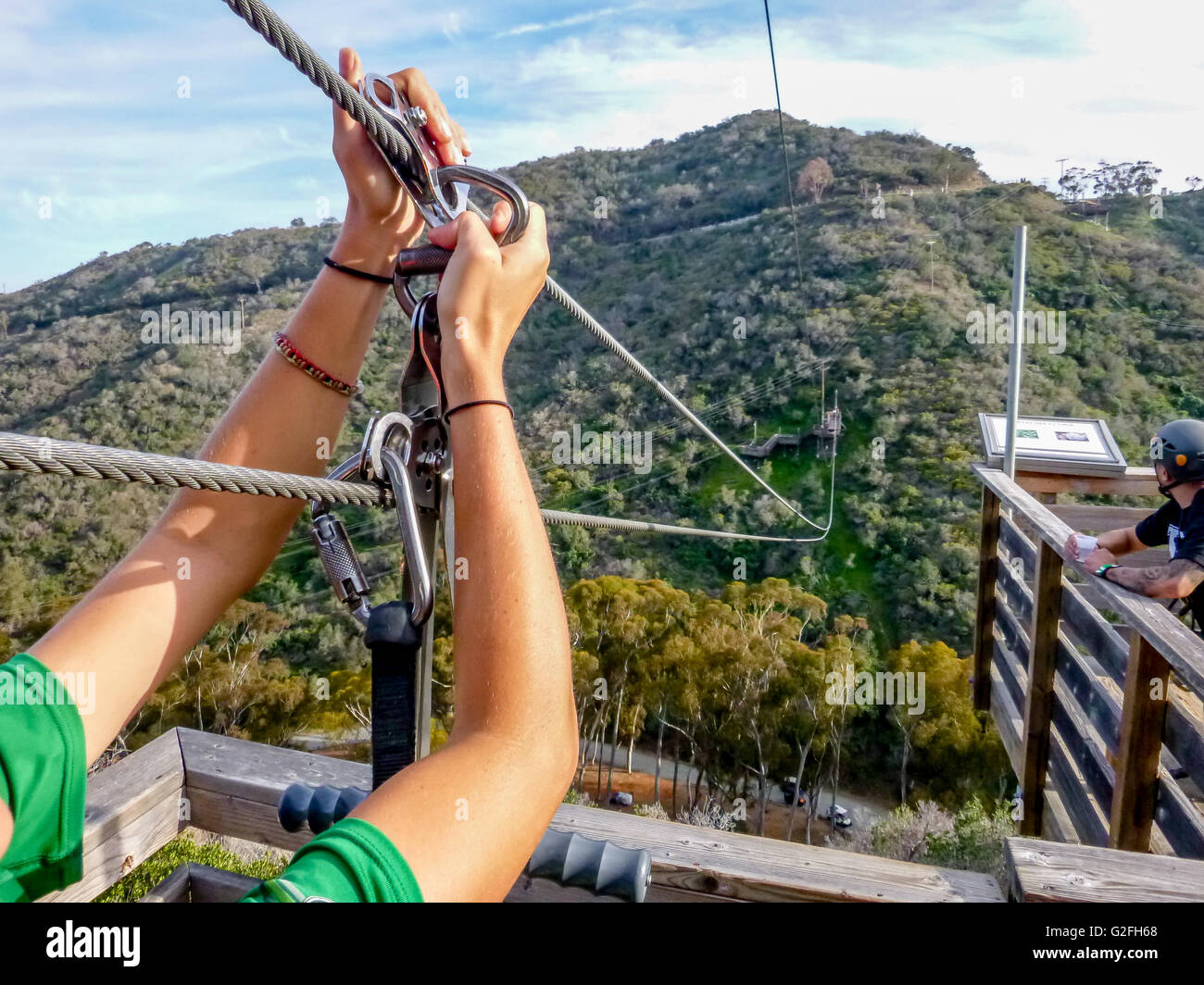 View from zip line platform, getting harness clipped by Catalina Zip Line Eco Tour at Avalon, Catalina Island, California. - Stock Image