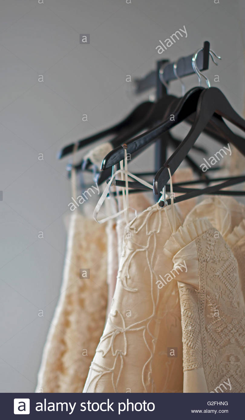 Handmade Wedding Gowns on Clothes Rack - Stock Image