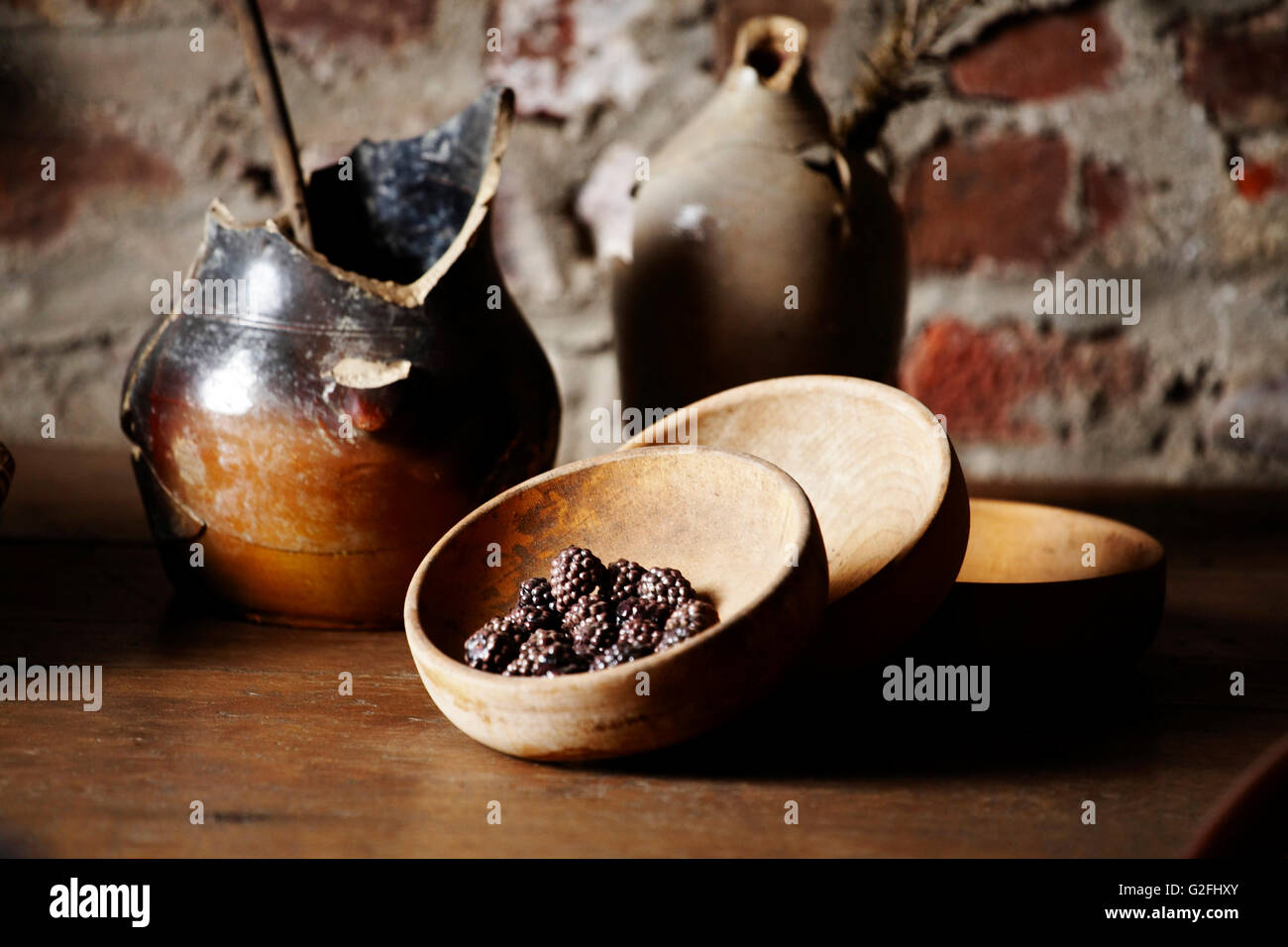 Primitive Wood Bowls and Pottery - Stock Image
