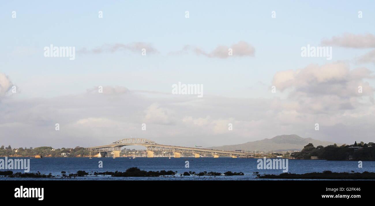 View of the Auckland Harbour Bridge and Rangitoto Island - Stock Image