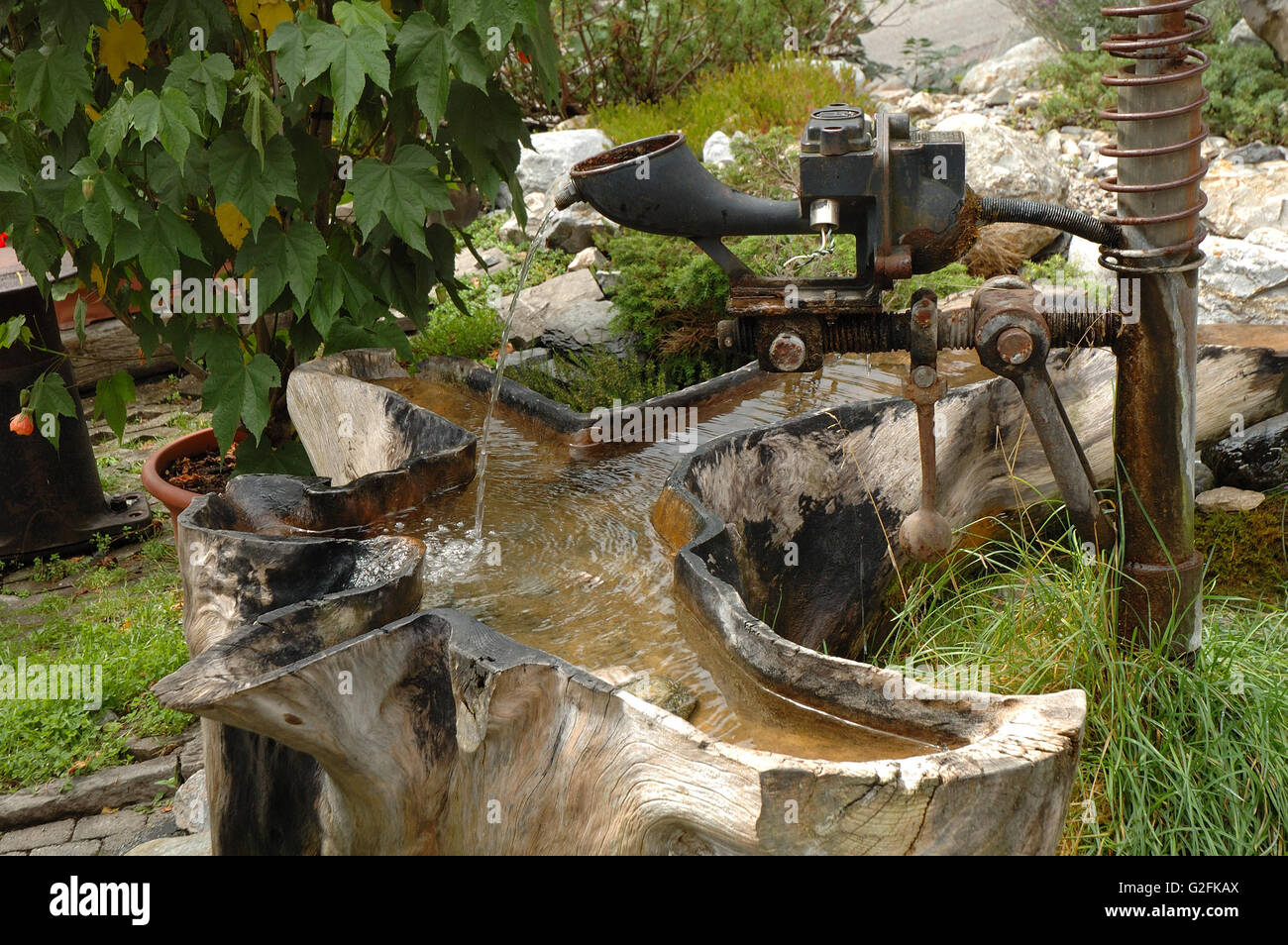 High Quality Small Unique Garden Fountain Made Of Old Metal Parts And Tree Trunk