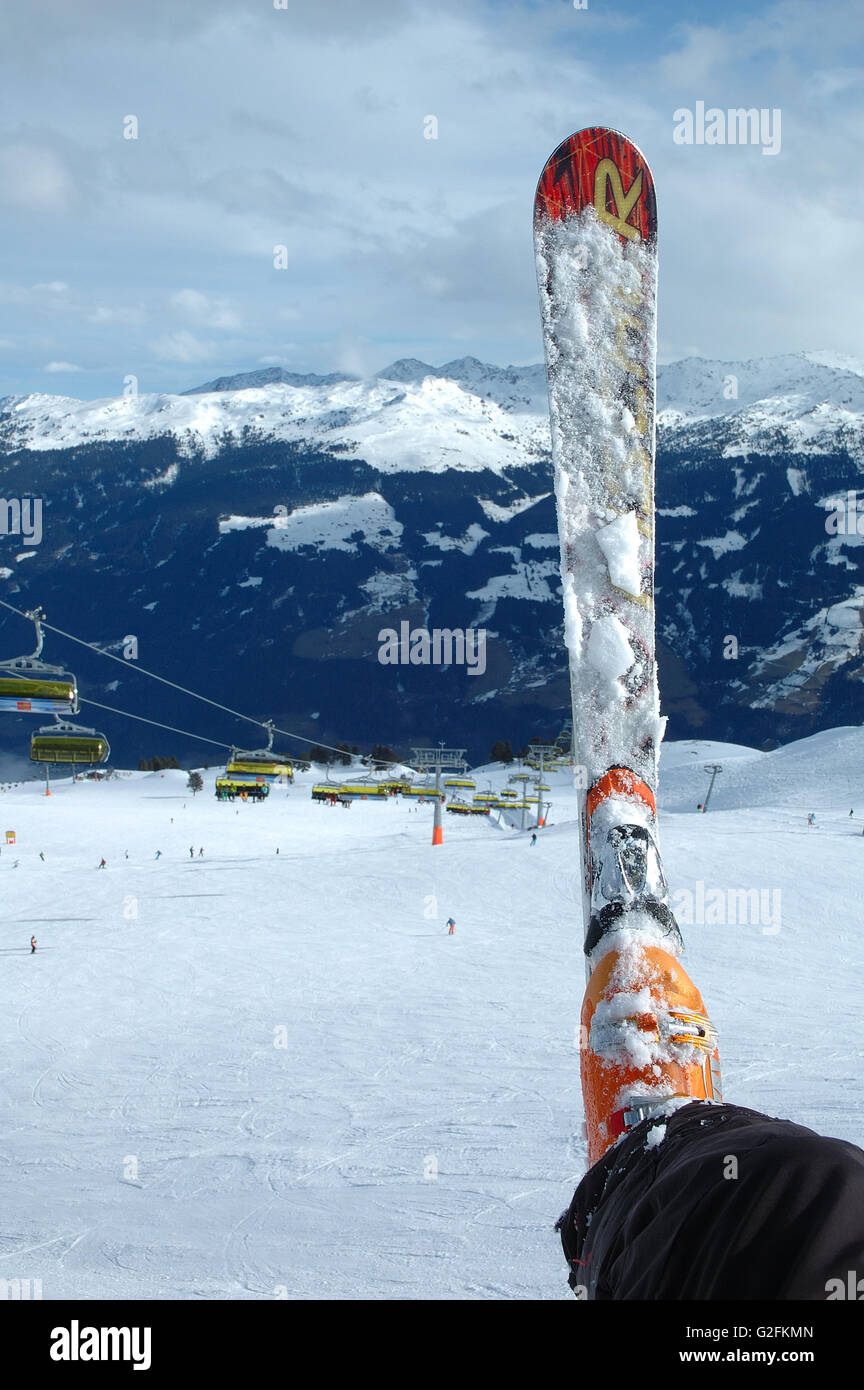 Ski and boot on the slope nearby Kaltenbach in Zillertal valley in Austria - Stock Image
