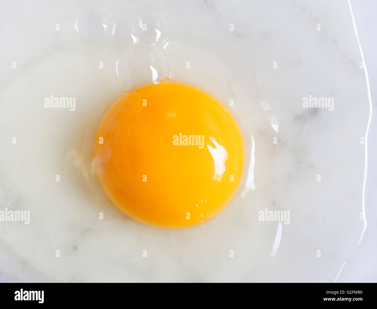 Egg Yoke On Counter - Stock Image