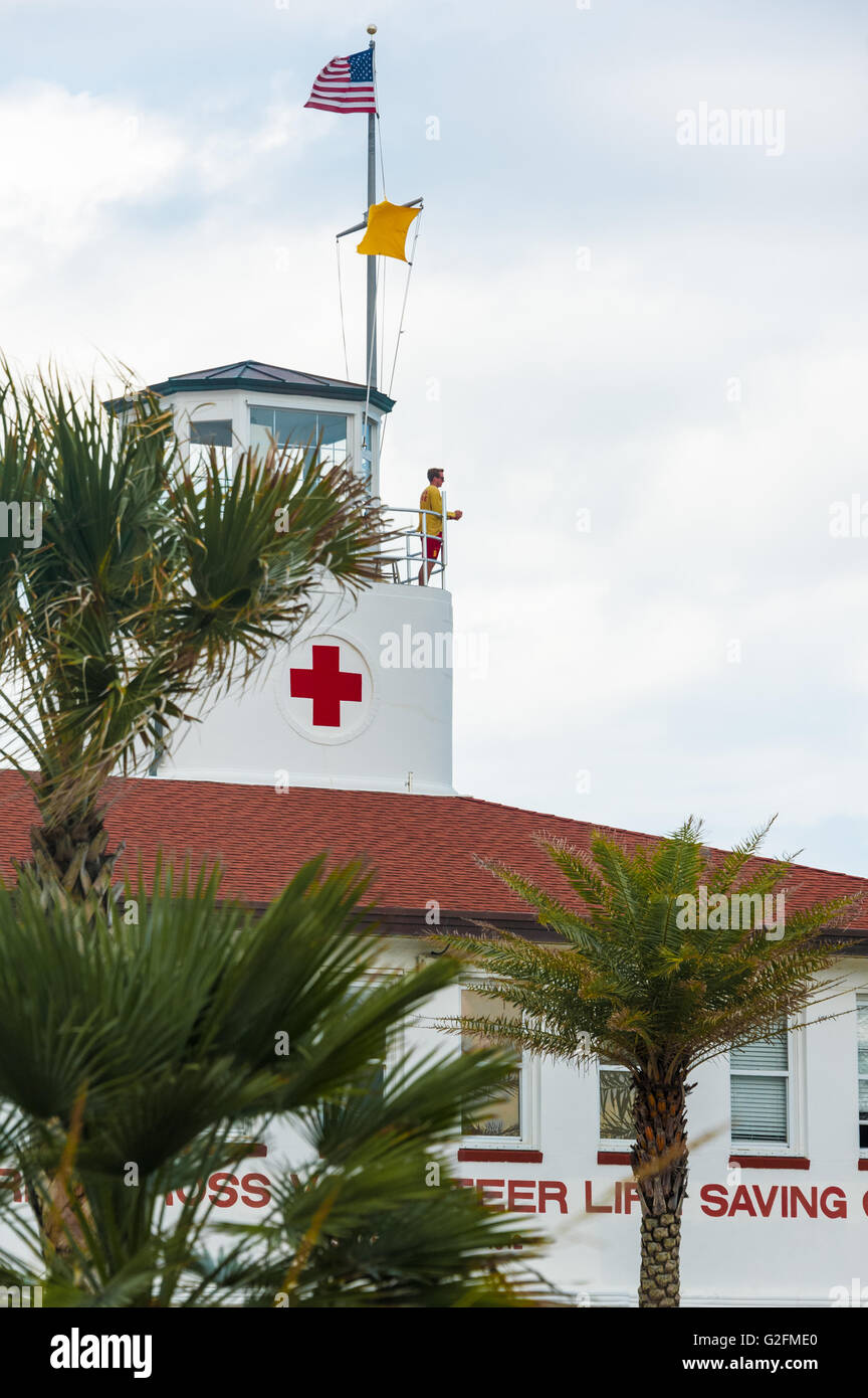 Lifeguard overlooking the Atlantic from American Red Cross Volunteer Life Saving Corps building on Florida's - Stock Image