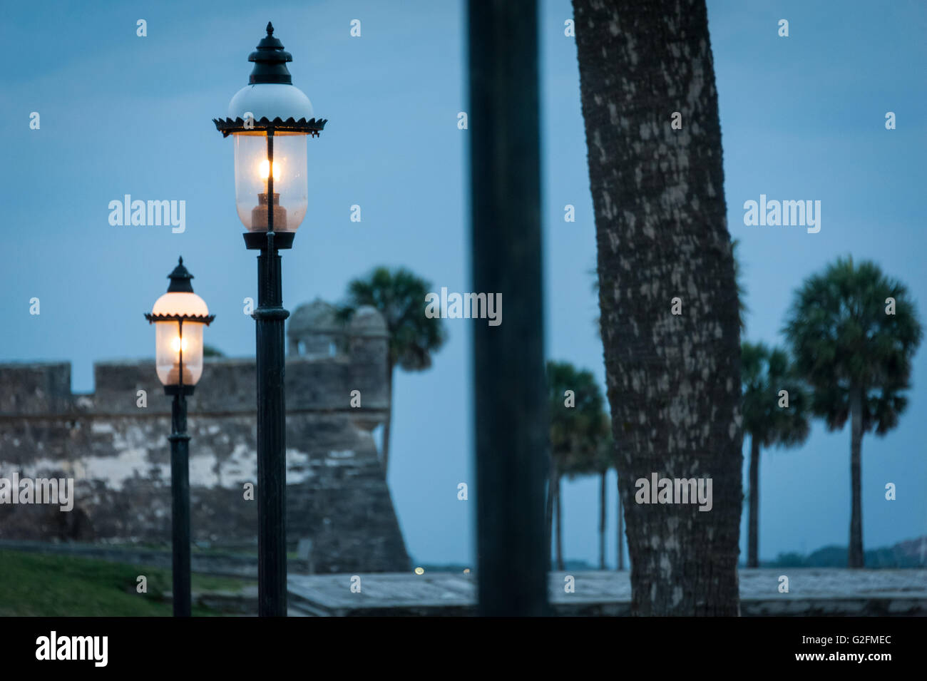 Glowing lamps along the bayfront at Castillo de San Marcos in St. Augustine, Florida, USA. - Stock Image