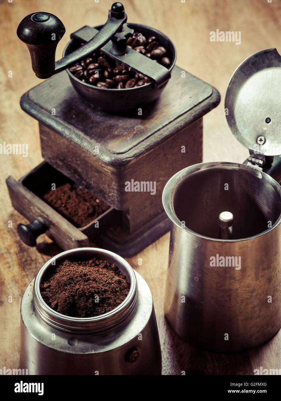 Photo of an Italian Moka Express stovetop coffee maker and a coffee grinder - Stock Image