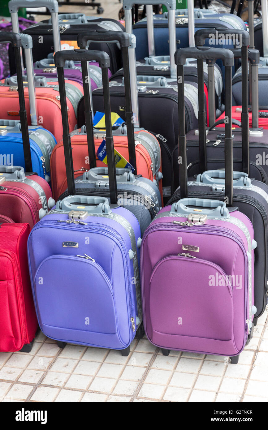 Wheeled suitcases on sale, Lanzarote, Canary Islands, Spain - Stock Image