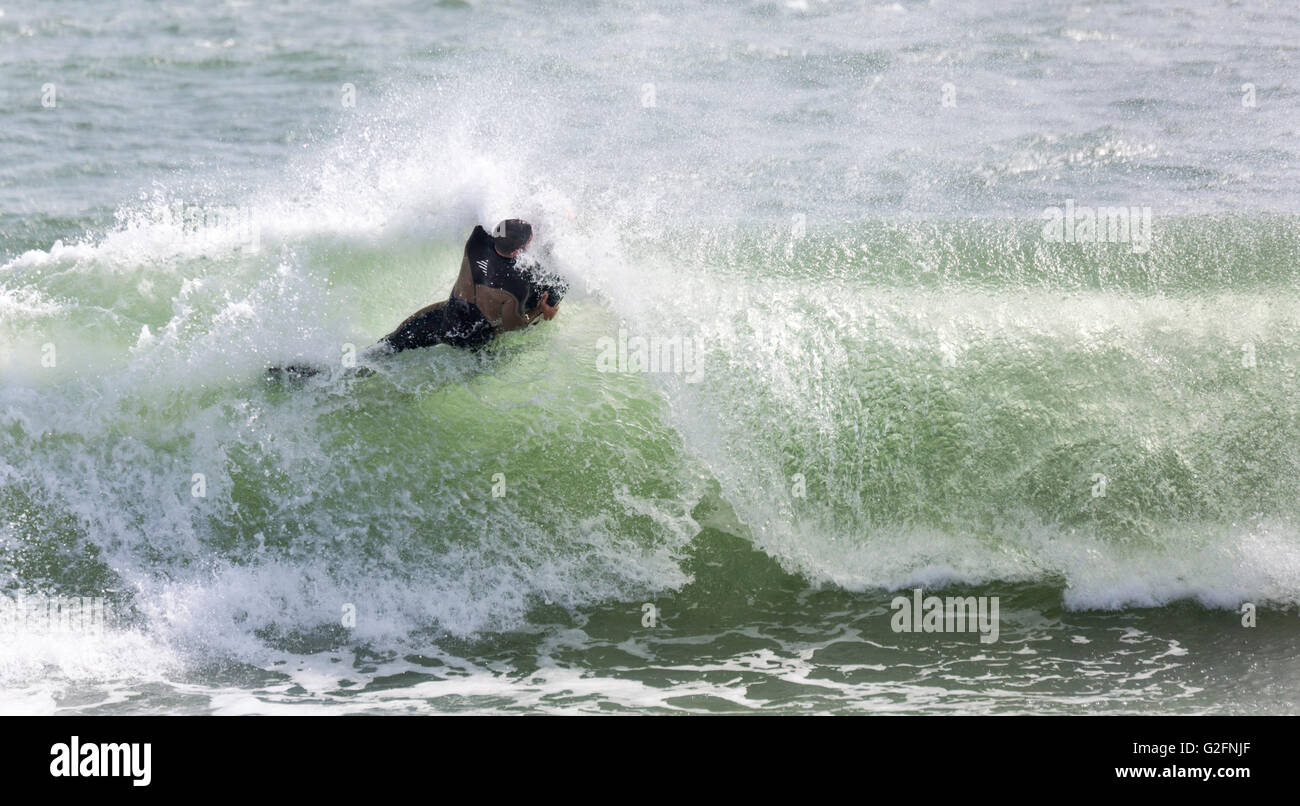 Belly board surfing, Praia de Faro (Mar), Algarve, Portugal - Stock Image