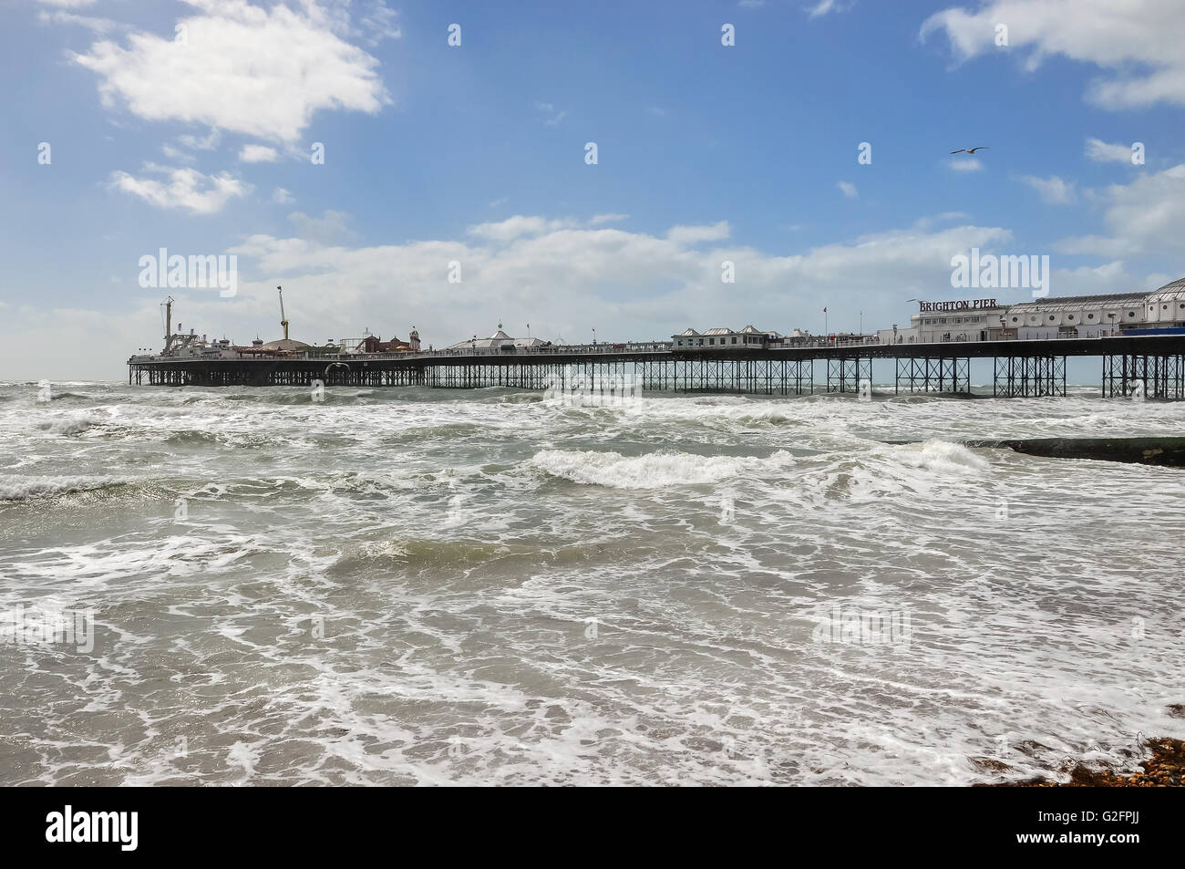 View of rough sea and Brighton pier on a windy day, United Kingdom - Stock Image
