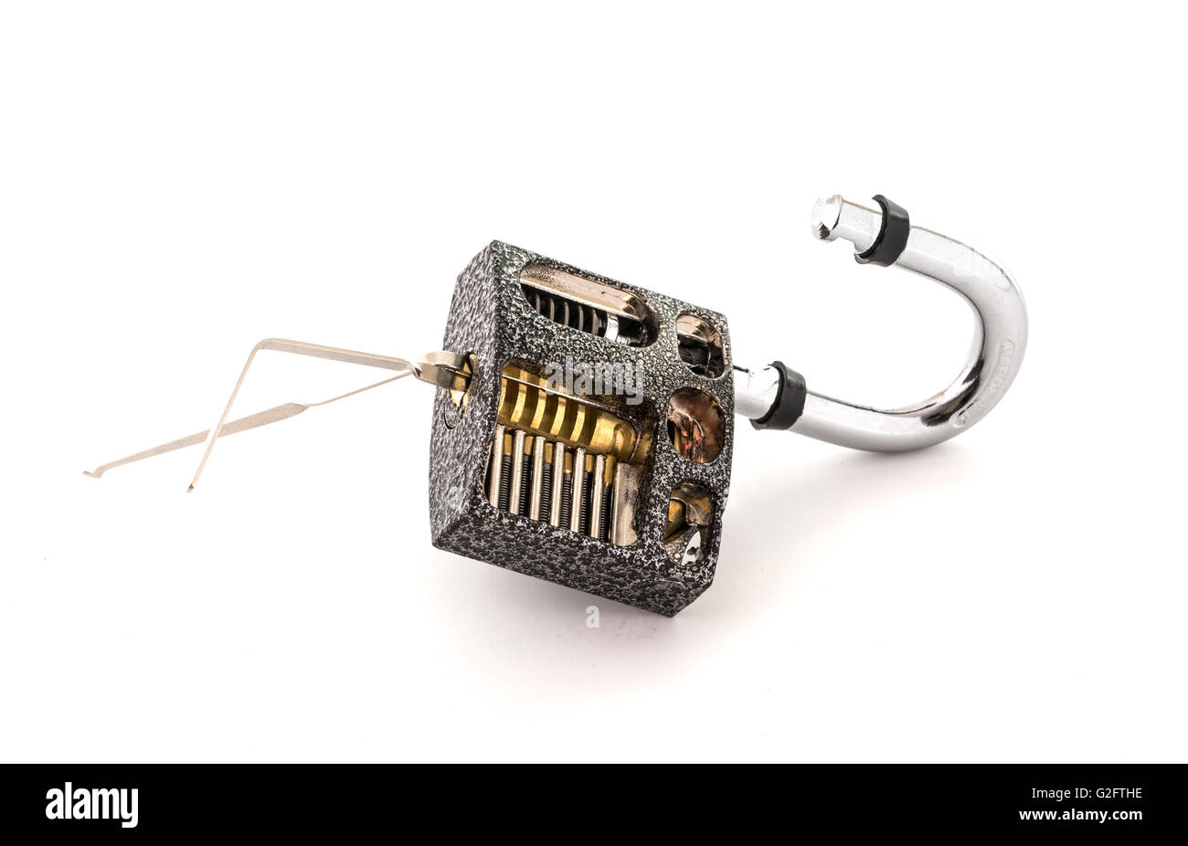 Cut Away Padlock and lock picks showing how a Padlock can be picked on a White Background - Stock Image