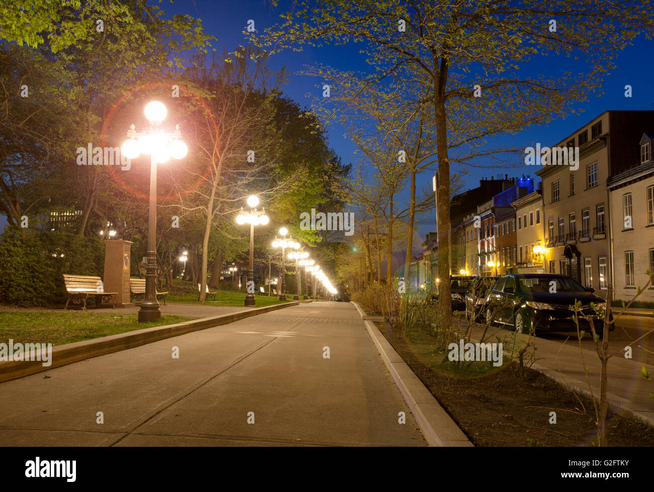 street l&s lighting up sidewalk in old Quebec City at night with light flares & street lamps lighting up sidewalk in old Quebec City at night with ...