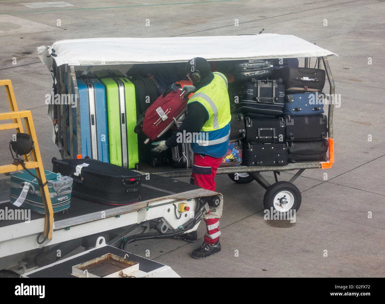 Baggage handler at Manchester airport. UK - Stock Image