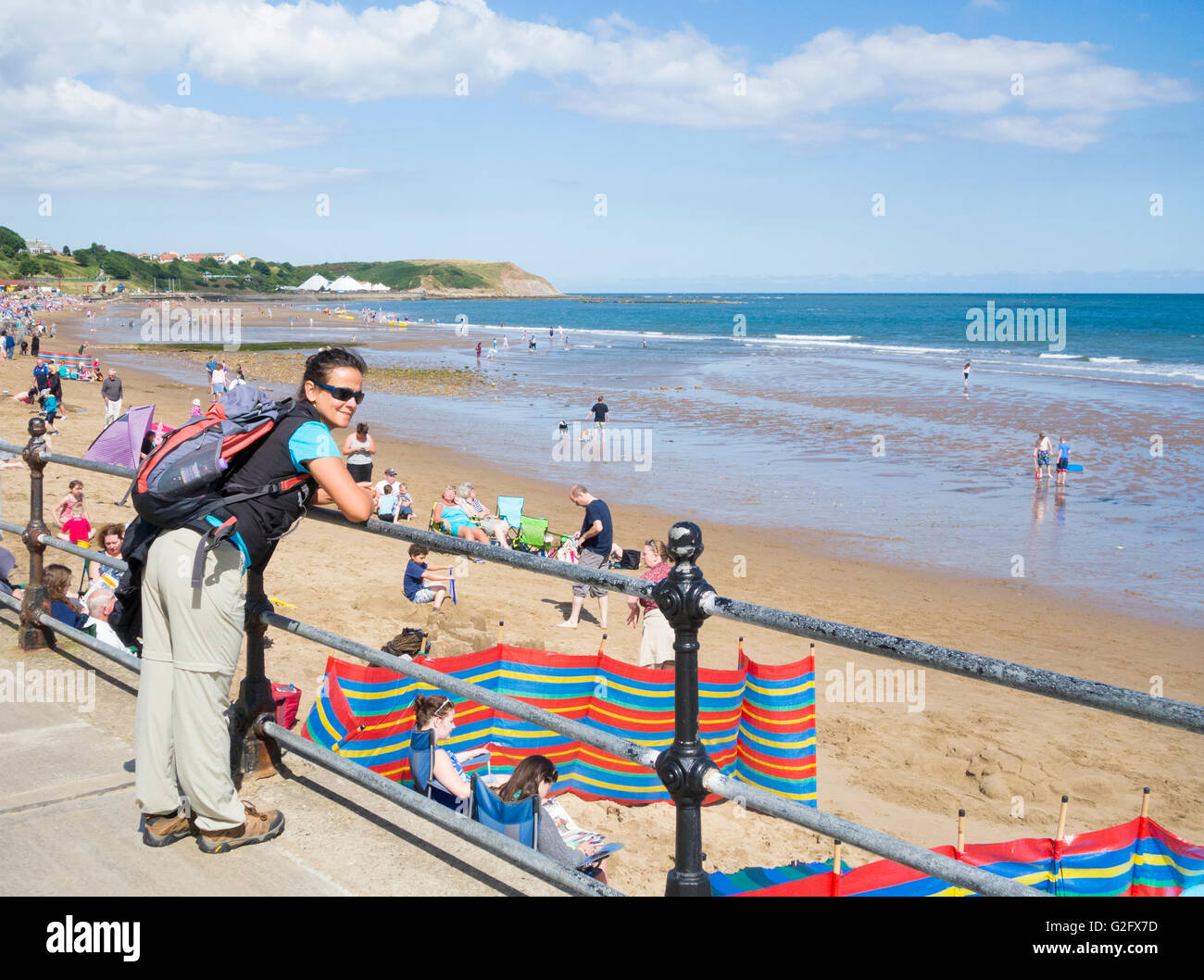 Female hiker overlooking North Bay beach, Scarborough, North Yorkshire, England, United Kingdom - Stock Image
