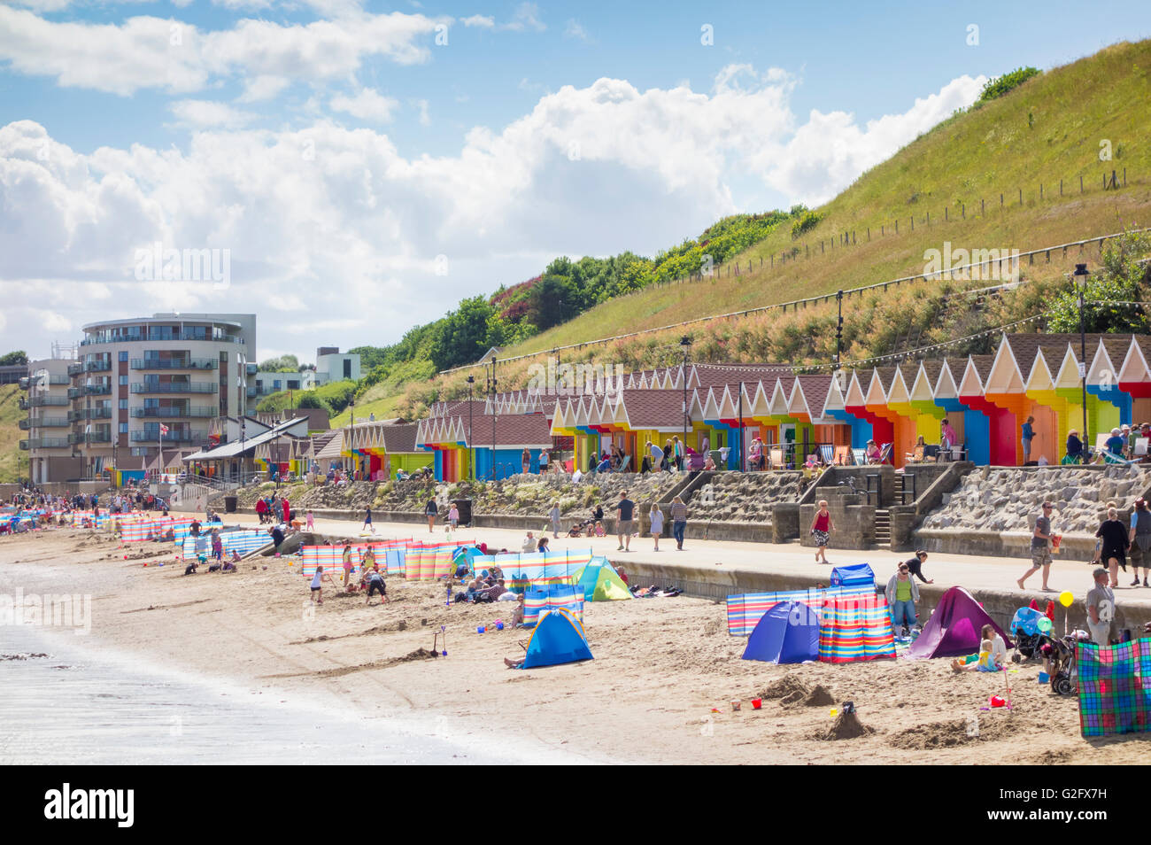 Beach huts overlooking North Bay beach, Scarborough, North Yorkshire, England, United Kingdom - Stock Image
