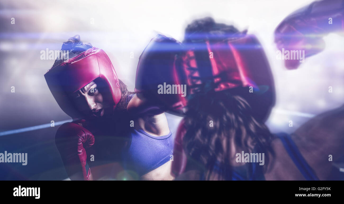 Composite image of rear view of fighter flexing muscles - Stock Image