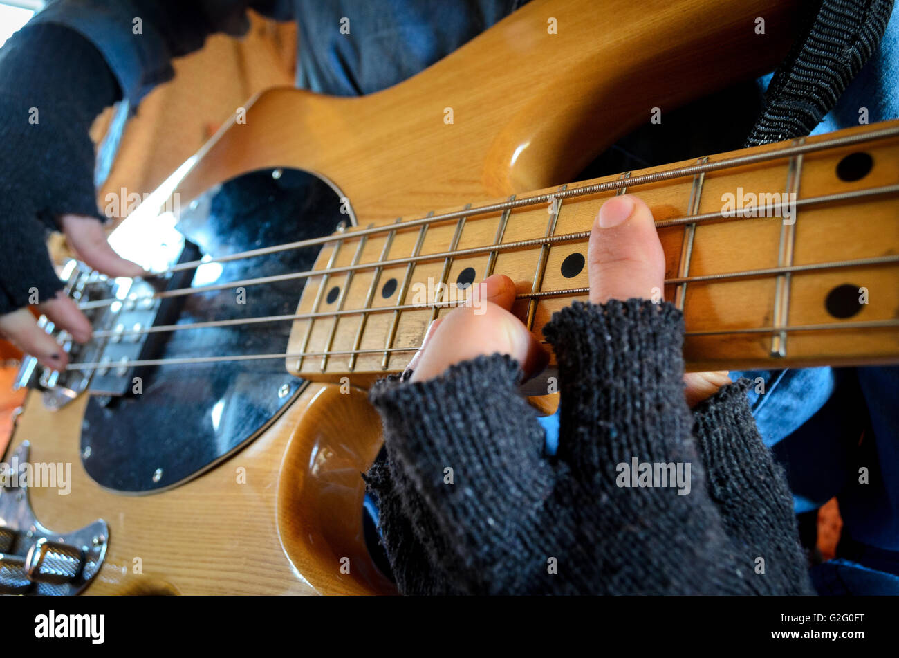 playing bass guitar wearing fingerless gloves stock photo 104843196 alamy. Black Bedroom Furniture Sets. Home Design Ideas