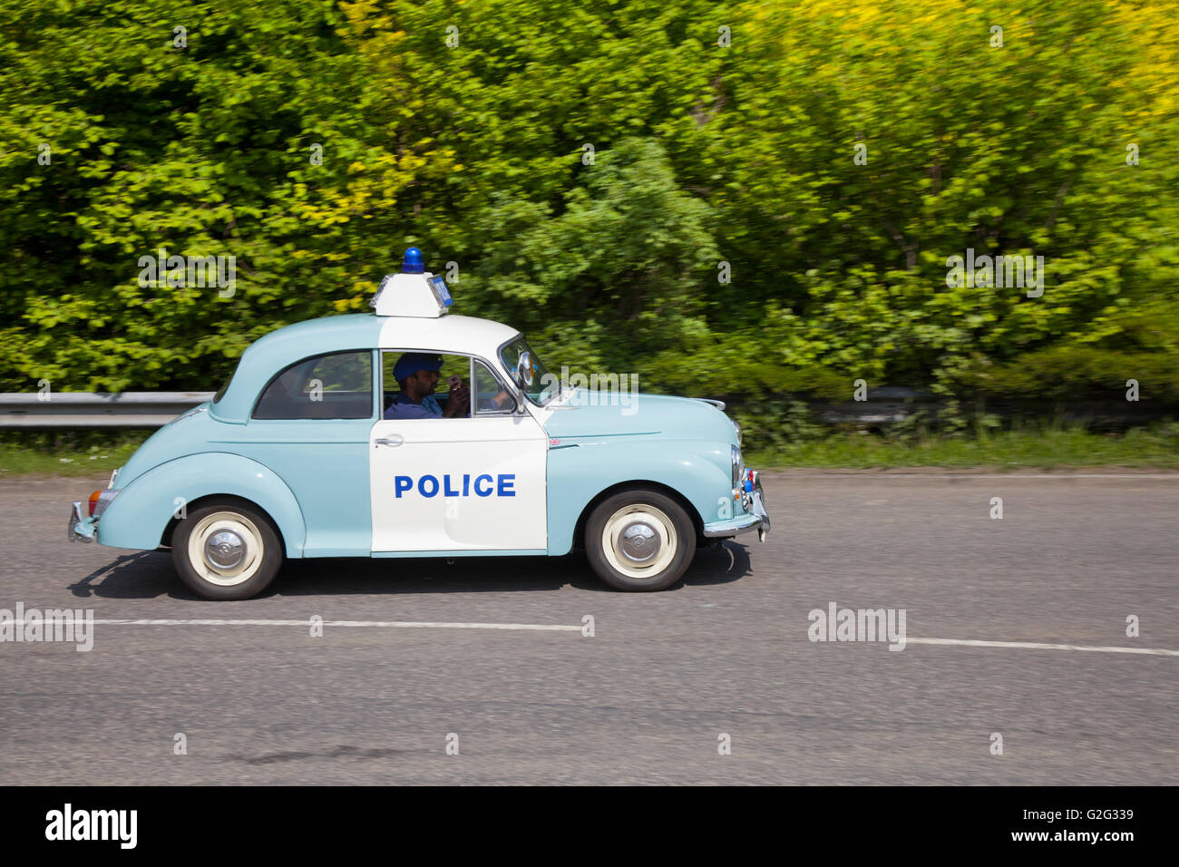 Vintage 1969 blue & white British Leyland Morris Minor 1000 Police traffic ZCar type. 60s Z-Cars or Z Cars was a British television drama series centred on the work of mobile uniformed police in a fictional town.   Police panda Car at the Pendle Power Fest, a classic, veteran and heritage motor show held at Barrowford, Lancashire, UK Stock Photo