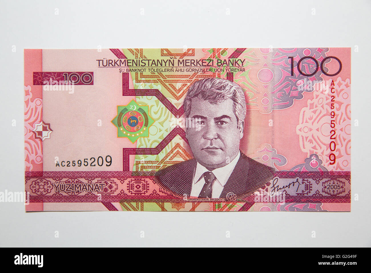 The front of the Turkmenistan 100 note featuring Niazov - Stock Image