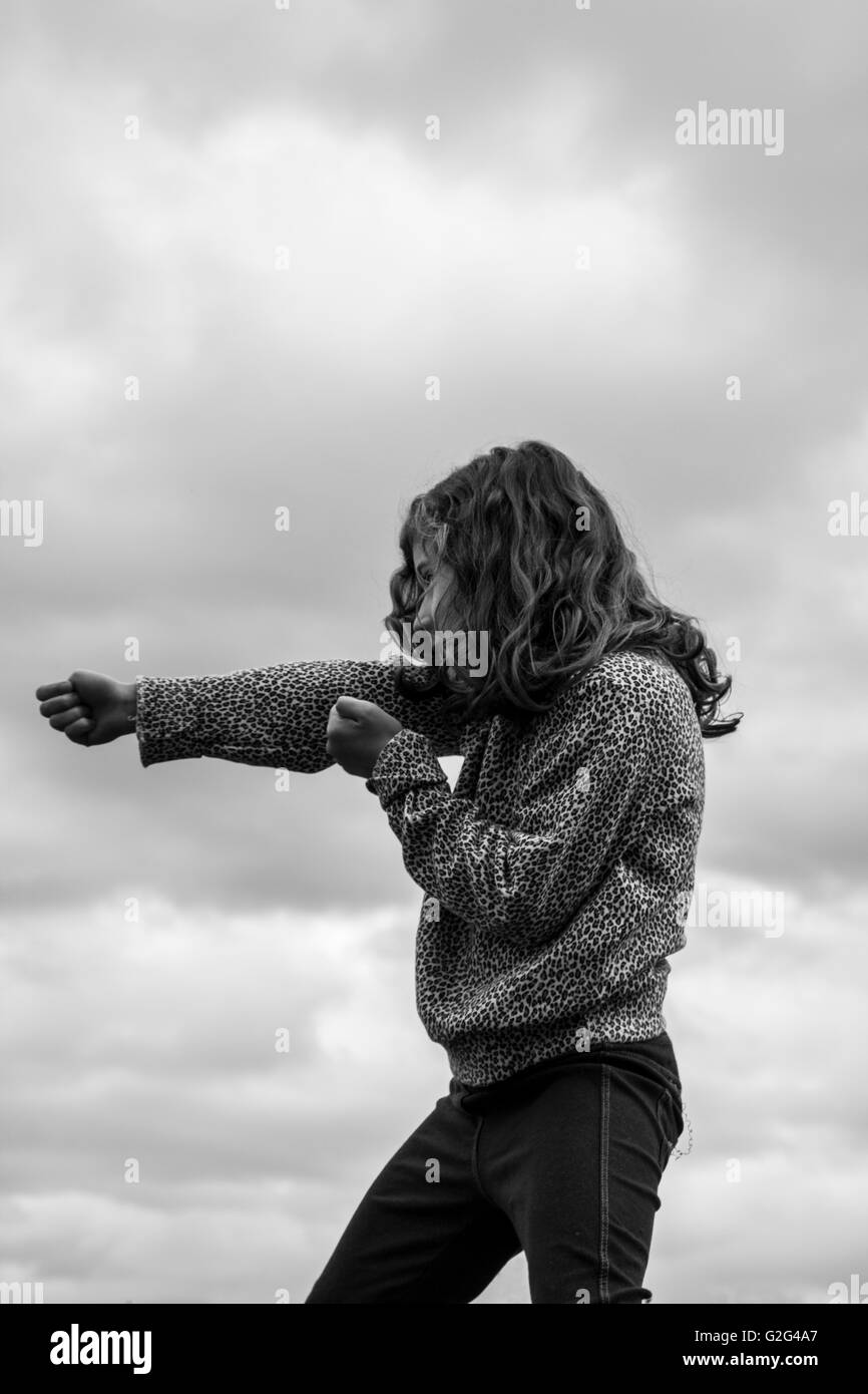 Young Girl Practicing Martial Arts - Stock Image