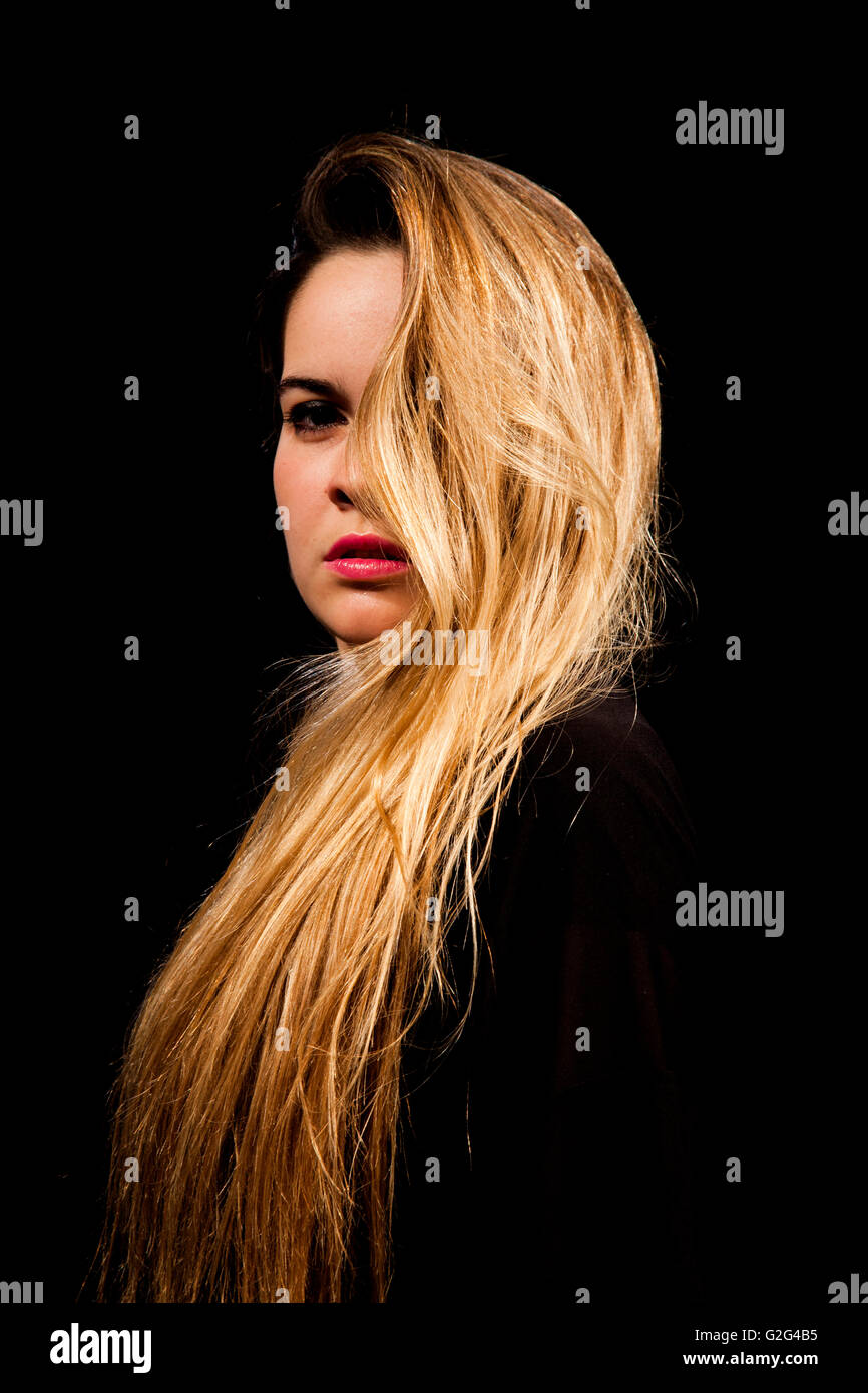 Portrait of Angry Looking Woman with Long Hair - Stock Image