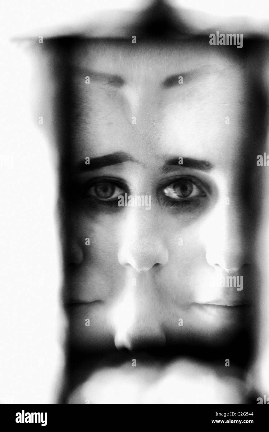 Abstract Doubled Face of Young Woman - Stock Image