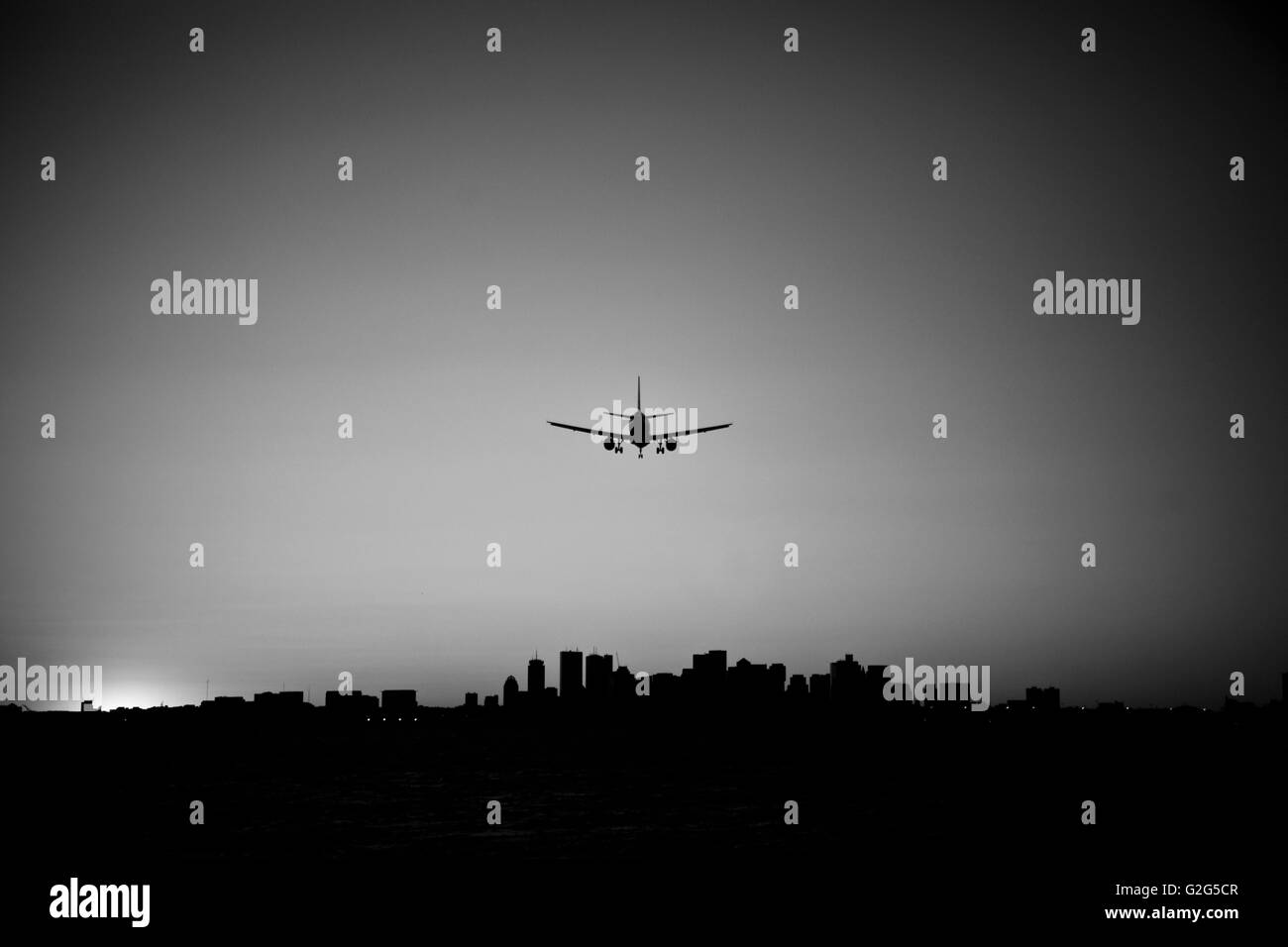 Airplane Approaching Airport, Boston, Massachusetts, USA - Stock Image