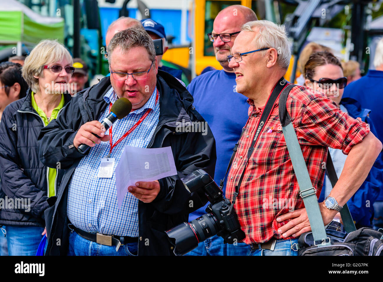Emmaboda, Sweden - May 14, 2016: Forest and tractor (Skog och traktor) fair. Photographer and speaker with microphone - Stock Image